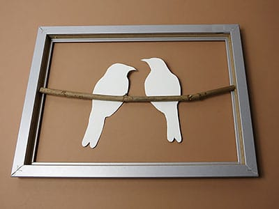 Vögel in Rahmen kleben