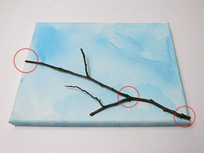 Zweig aufkleben
