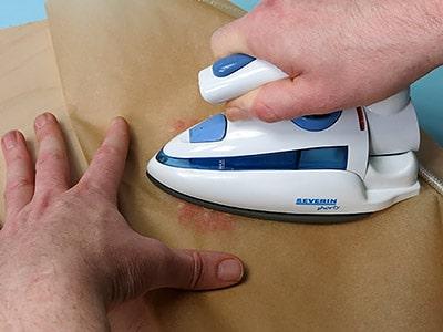Scheibe bügeln